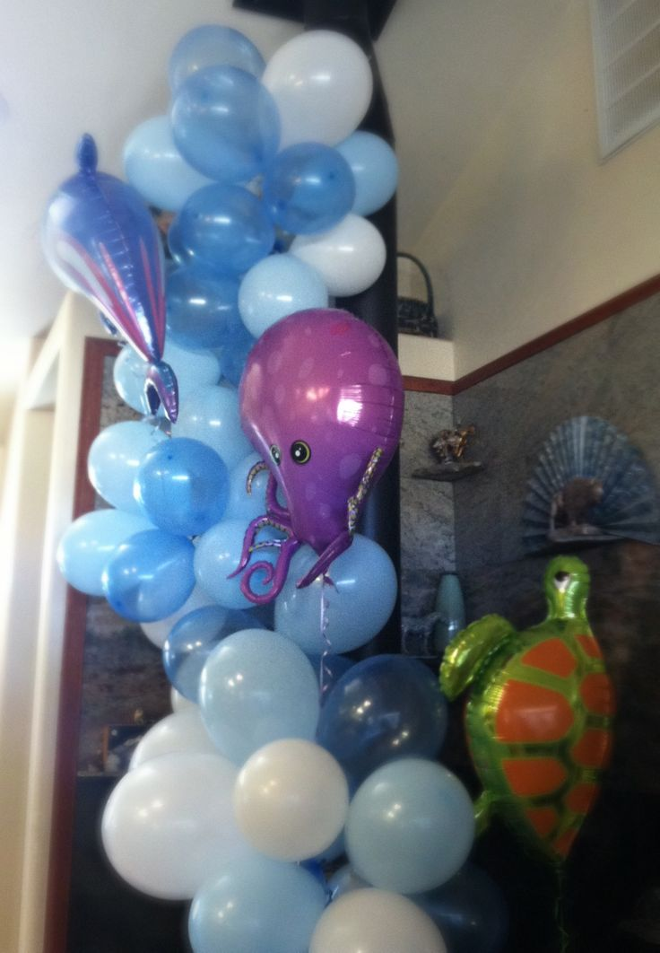 Under the Sea baby shower.  Blow up colored balloons and string onto fishing wire with tapestry needle. Helium is only needed for the floating sea creatures.