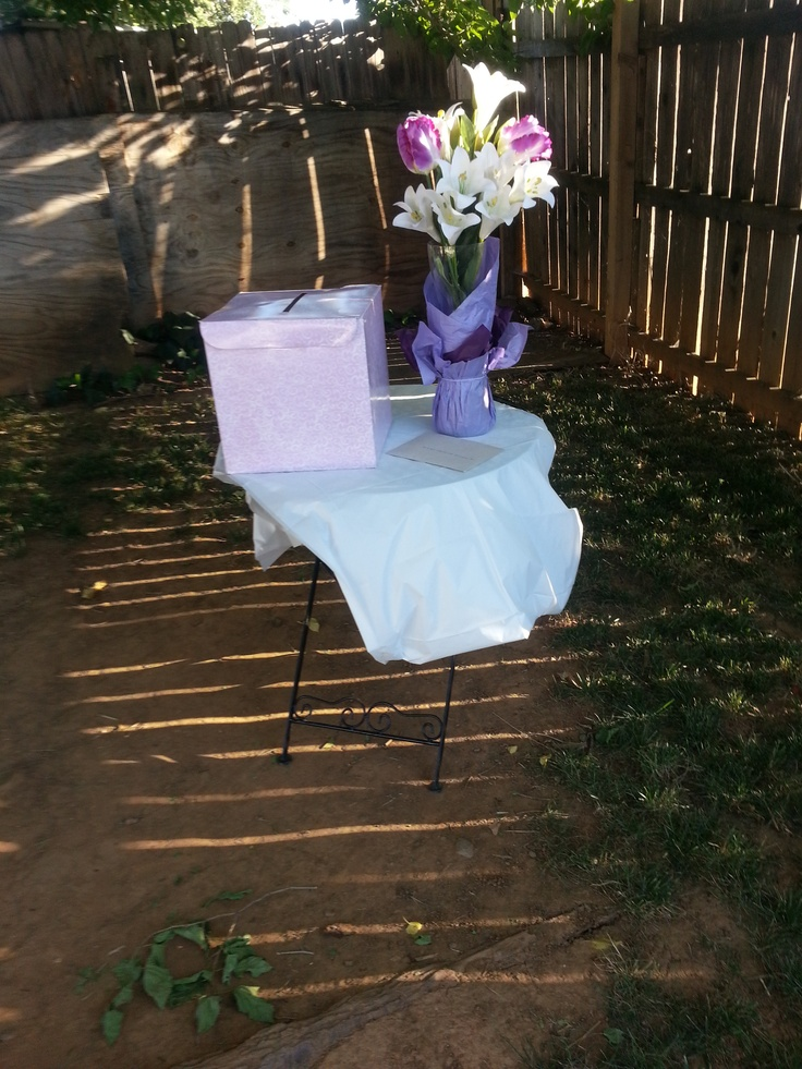 The gift table was plaved particularly in this area because of the bare spot beneath the true. It worked great because it was in veiw of the bridal party table!