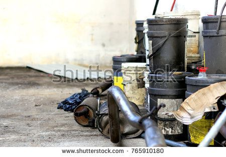 hazardous waste from the automotive industry with soft-focus and over light in the background