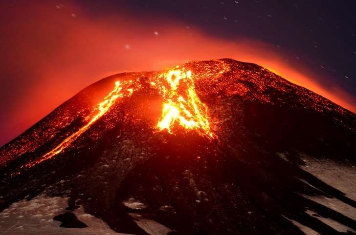 The Villarica volcano erupts near Pucon, Chile, early Tuesday, March 3, 2015. The Villarica volcano erupted Tuesday around 3 a.m. local time (0600 GMT), according to the National Emergency Office, which issued a red alert and ordered evacuations.