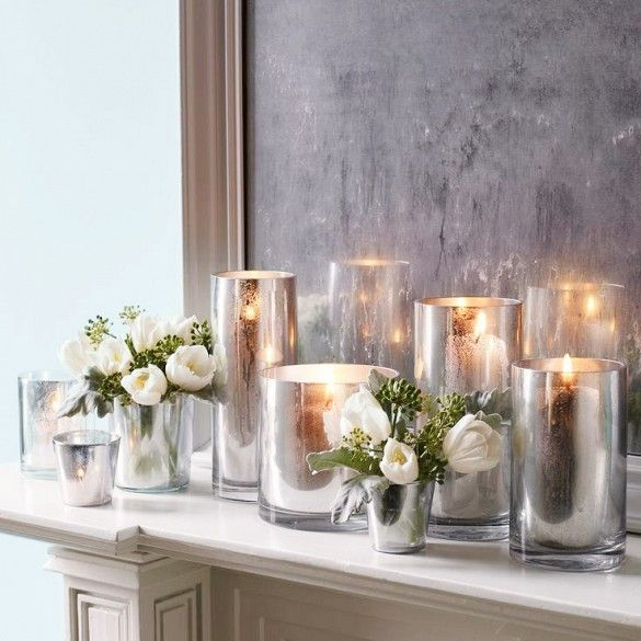 Chrome vases with candles inside and small roses