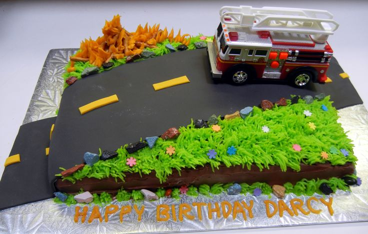 Fire truck Cake. The fire truck actually lit up and had a siren. More fun for the birthday boy than making it out of fondant I thought! And faster too!