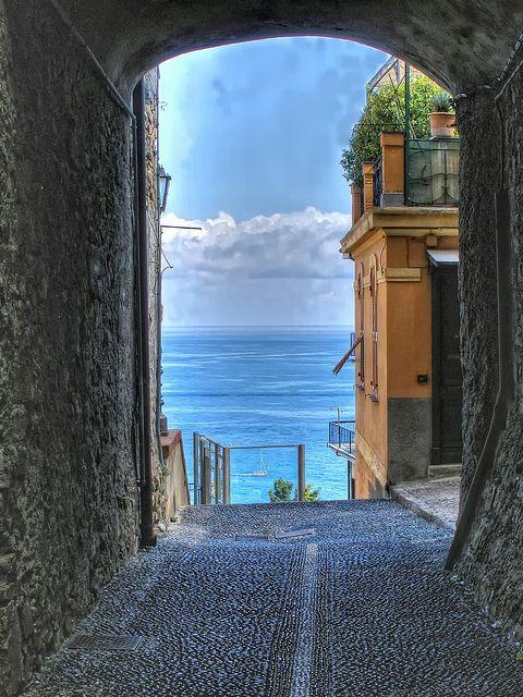 Sea behind the alley, Porto Maurizio, Liguria.