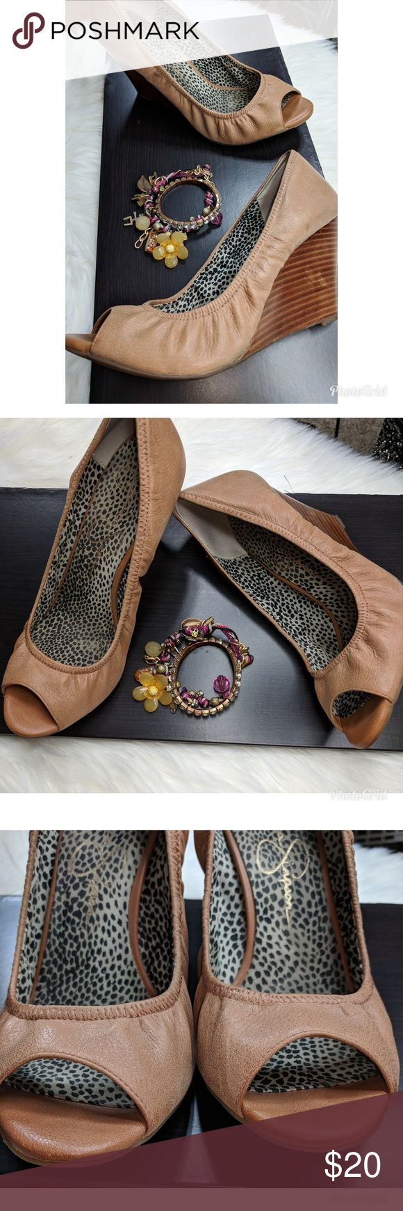 Jessica Simpson Camel Wedges Jessica Simpson Camel Wedges   Shoes have been previously Loved   Shoes don't have size on them  Please look at chart and pictures of size chart    Wear shown in pictures  Suffering on back of the right shoe  Always open to offers  I ship fast Jessica Simpson Shoes Wedges
