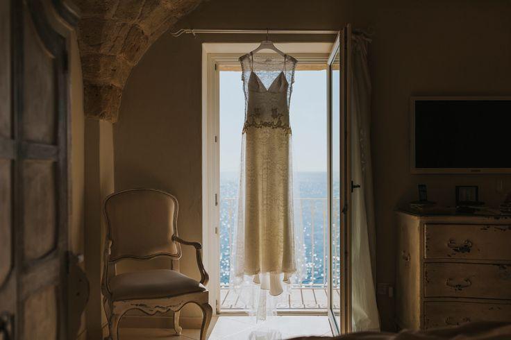 Beautiful wedding dress perfect for a warm Italian wedding. In the bridal suite at Don Ferrante, Monopoli, Italy. Photo by Benjamin Stuart Photography #weddingphotography #donferrante #monopoli #italianweddingvenue #weddingdress #destinationwedding #hotwedding #summerwedding