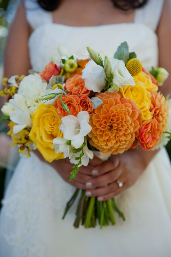 Citrus colored wedding bouquet {Photo by Tia & Claire Studio via Project Wedding}