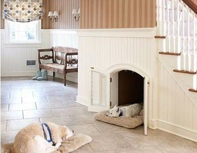 built in dog kennel under stairs opening to hall or living room