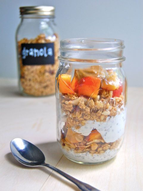 14 Overnight Mason-Jar Breakfasts- Peach Parfait- Layer diced peaches, Greek yogurt, and homemade or store-bought granola. Chalkboard label optional. Learn more delicious overnight oat recipes at redbookmag.com.