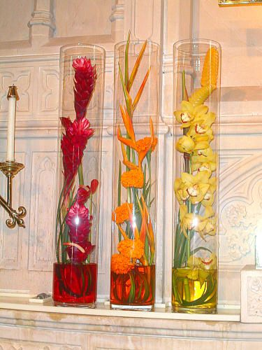Ginger, Heliconia, and Orchid centerpieces & it could keep going to represent the colourwheel too!!