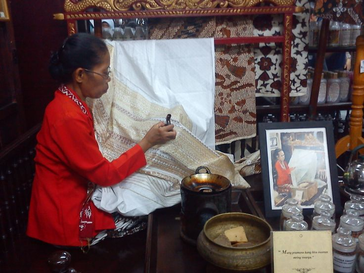 "She is doing ""membatik"" in one of big handcraft shop ""Mirota"" ...Malioboro Street,Jogjakarta Indonesia"