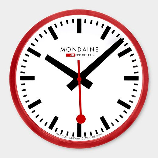 MOMA - Small Swiss Railway Wall Clock  Based on railway engineer Hans Hilfiker's 1940s classic, the Swiss Railway Station Clock is a standard throughout European train stations, with over 3,000 clocks keeping precision time. The straightforward black and white face with a red second hand is easy to read from a distance. Made by Mondaine with a red aluminum case and German clock movement.