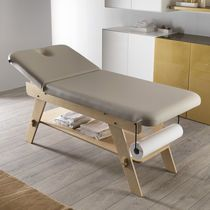 Fixed massage table