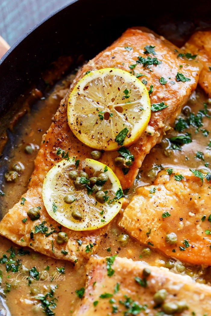 Easy Salmon Piccata | A lightened up, quick and easy Salmon Piccata with all of the authentic Piccata flavours of lemon, garlic and capers, and the optional white wine. Anything Piccata sounds so refined and way too complicated to cook, but this recipe is easy, gourmet cooking in minutes! Have I mentioned before how much I love food? How much I love eating exquisite good food? Cue this salmon.