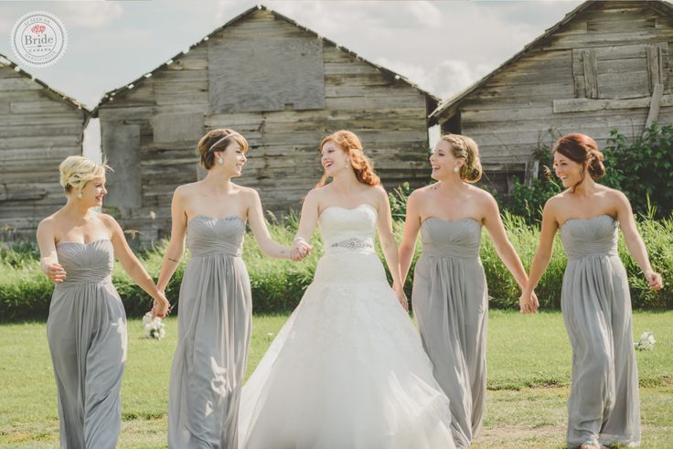 #weddinginspo: To match the wedding palette with their outdoor venue, Courtney & Warren opted for shades of teal, silver and light grey ! Courtney bridesmaids all wore simple empire-waist @davidsbridal dresses to contrast with her white, A-line @pronovias gown ! . . . Photography: @kristilee_parish Brides' Dress: @Pronovias Bridemaids' Dress: @davidsbridal Blog Story: @diyweddingsmag