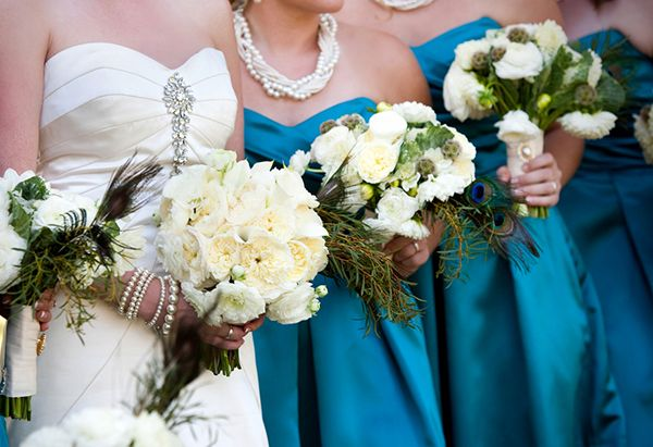 white and ivory bride and bridesmaids bouquets, teal bridesmaids dresses. Peacock colors! Beautiful.