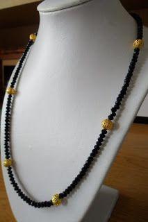 Silvia Jewellery of Style: Collana nera e dorata luminosa