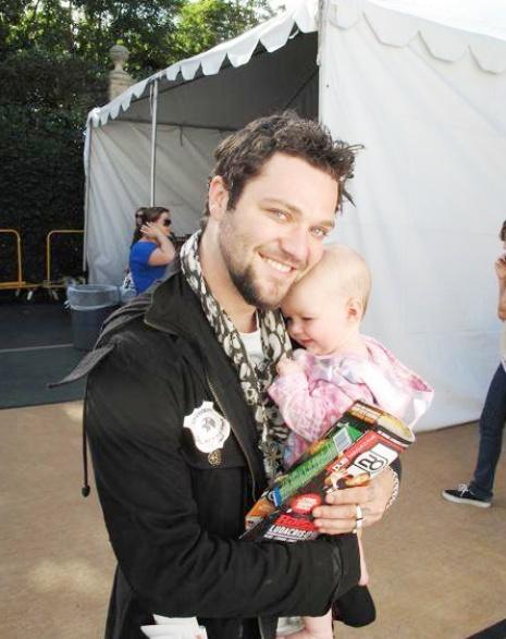 bam margera holding baby