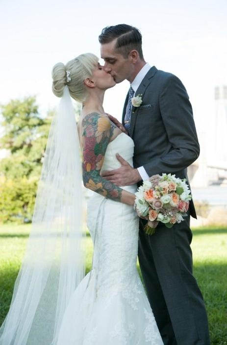 Why be a typical boring bride? Add some beautiful art to your photos with your tattoos. Don't be ashamed