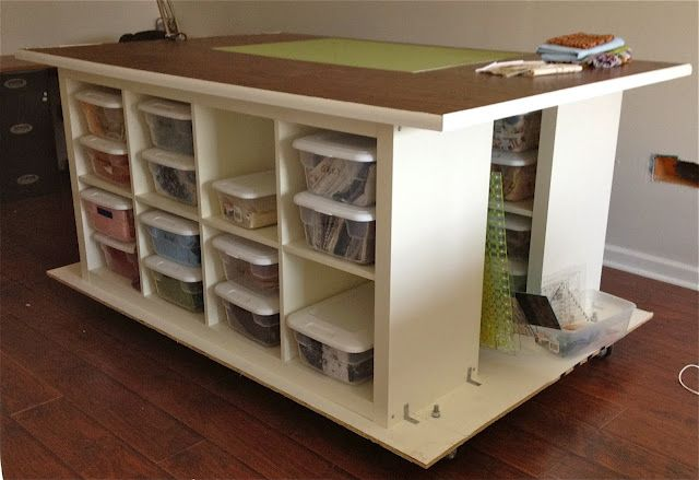 Quilters Table with storage on wheels built from 2 IKEA Expedit (2 x 4) bookcases and 2 sheets of plywood
