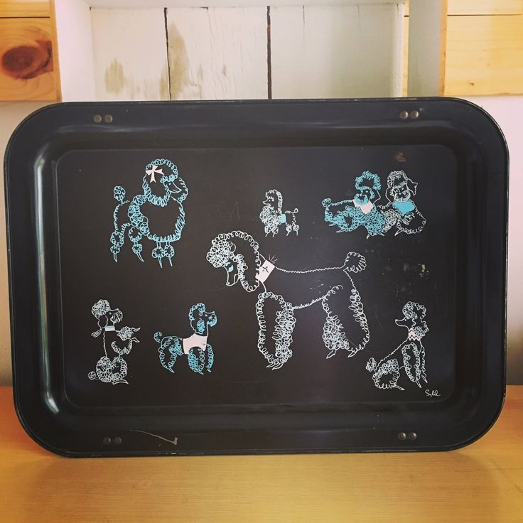 A personal favorite from my Etsy shop https://www.etsy.com/listing/540390395/midcentury-tv-tray-poodles-collapsible