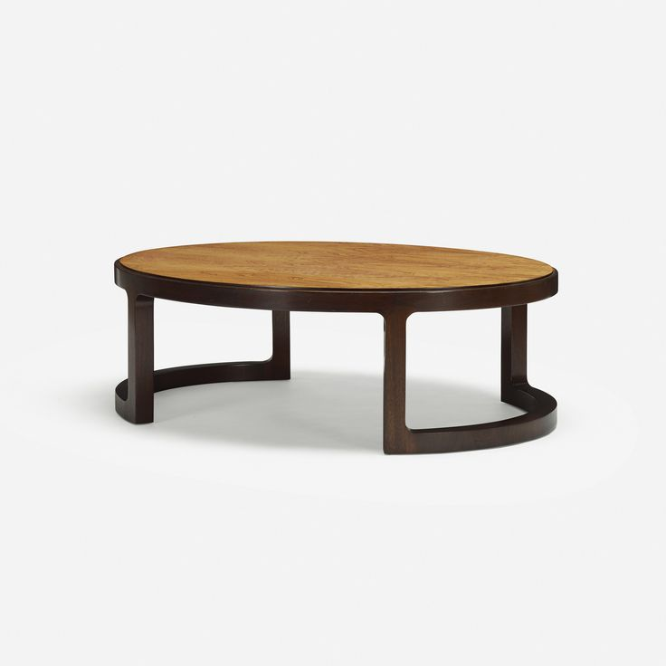 Lot 285: Edward Wormley. coffee table. c. 1967, stained mahogany, rosewood. 49 w x 39 d x 16 h in. estimate: $2,000–3,000. Signed with applied brass D manufacturer's label to underside: [Dunbar Berne, Indiana].