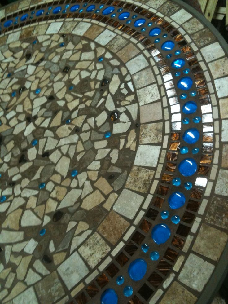 Mosaic patio table.  Have broken pottery I've been saving to do something like this...