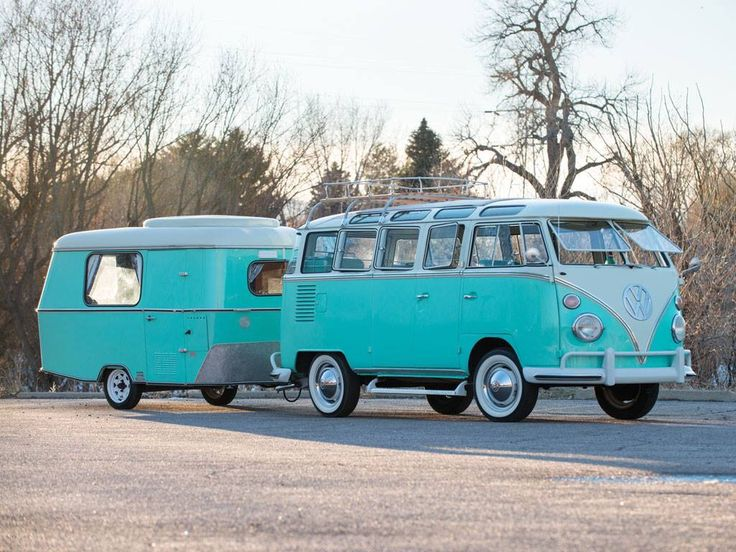 1963 Volkswagen Type 2 '23-Window' Super Deluxe Microbus with Eriba Puck. Sold at auction for $159,500 according to Vintage Camper Trailers.
