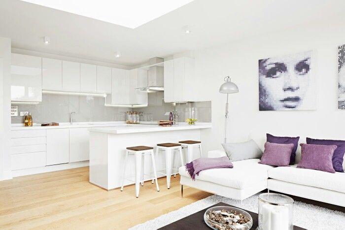Glendon Apartments by QNEWHOMES LTD Bespoke open plan kitchen / living room, glass splashbacks, corian worktops, oak floors.