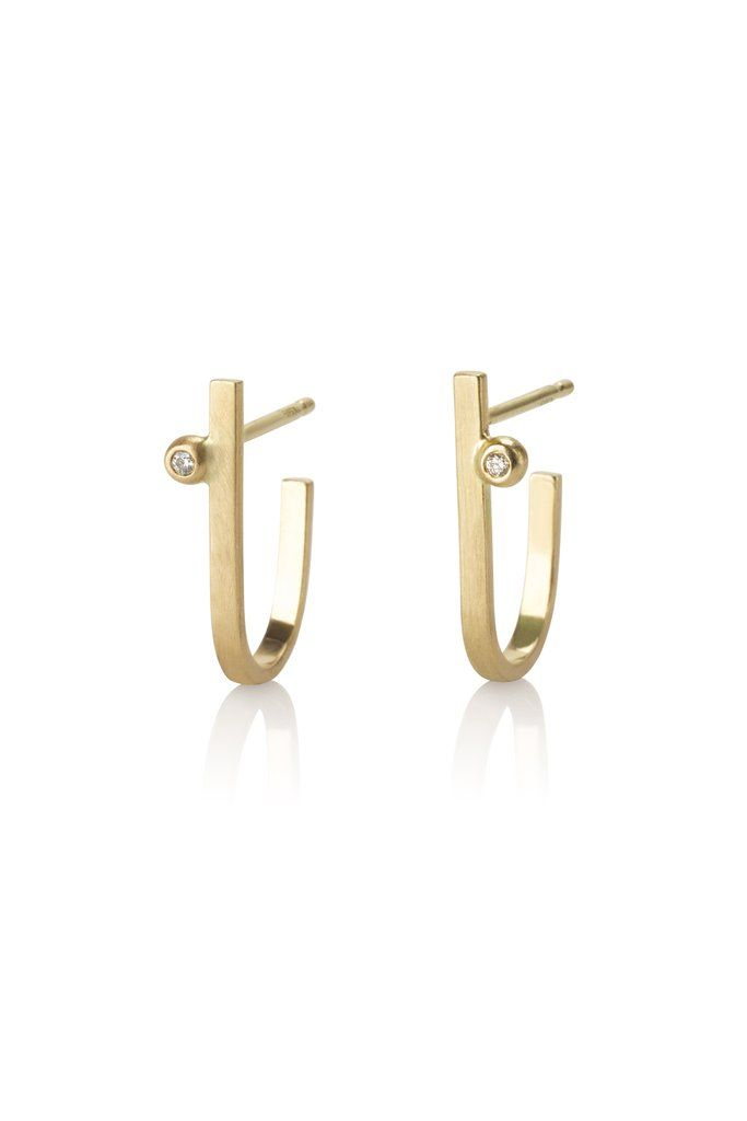 Kimora earrings / 14k gold and diamond earrings  By CONTOUR STUDIO  Simple and pretty long gold studs that curve around the earlobe, set with 2 little diamonds. Minimalist and elegant studs perfect for everyday use.