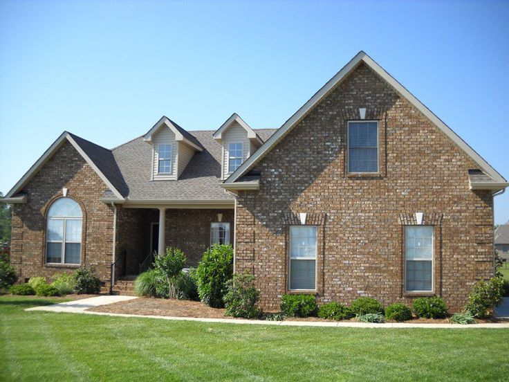 A Beautiful Brick Home With Features Like Arches And
