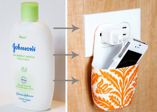 "An ""aha!"" moment: By simply cutting up an emptied lotion bottle, design blog Make It and Love It crafted a super cheap charging station. Cut down to a cup shape, the bottle is the perfect size to fit flush up against the wall without blocking the adjacent outlet. The holder was beautified with some fabric and Modge Podge."