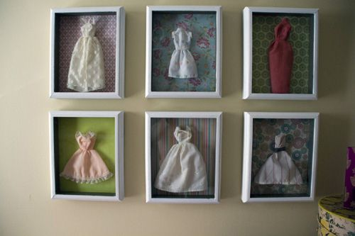Barbie dresses placed in shadow boxes with scrapbook paper backgrounds. Cute girl's room display.