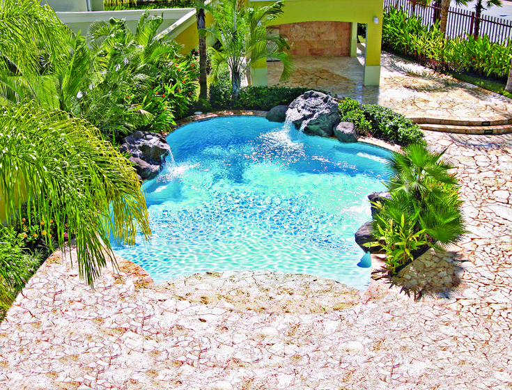 Blue Haven Tropical Beach Entry Pool With Small Rock Waterfalls.