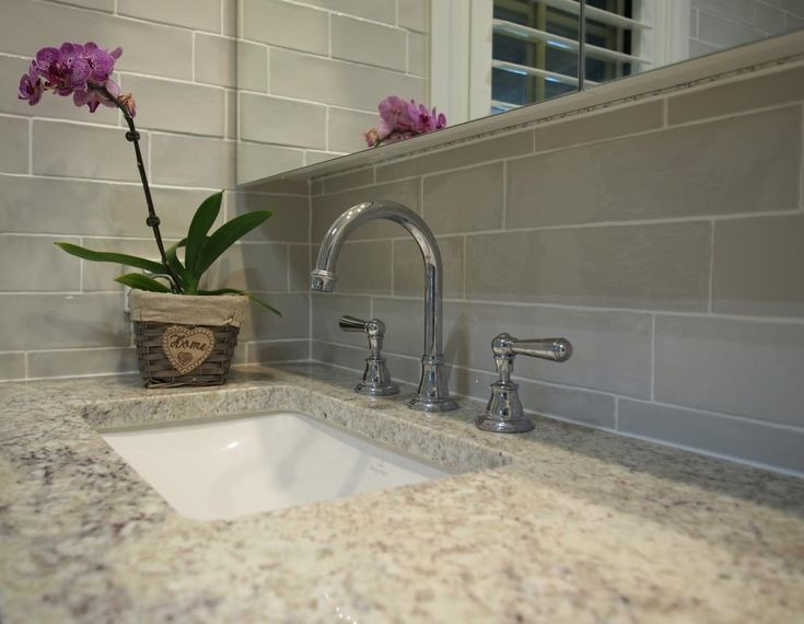 Traditional lever tapware and gooseneck spout.  Handmade-look subway tiles.