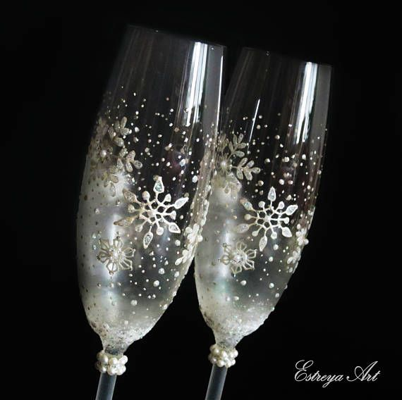 """Set of two hand painted toasting flutes """" Snowflakes"""" These beautiful glasses with snowfakes are in white, decorated with a hint of glitter and pearls. They are unique and perfect present for Christmas, winter weddings, anniversaries, birthdays, special occasions, unique gift for couples. All items can be personalized with short text as names and/or date written at the base of the flutes /no additional fees apply/ so just write your wish in Notes to seller field at checkout. ..."""