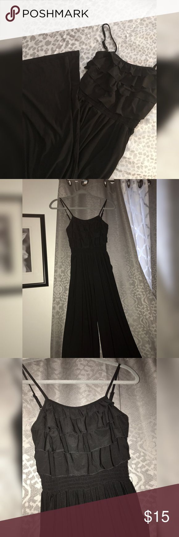 Black one piece wide leg jumpsuit! Black one piece wide leg jumpsuit with ruffle detail at the top! Never worn! NWT❕Size: Small Stretchy & silky material I'd say could fit a size S/M too! Pants Jumpsuits & Rompers