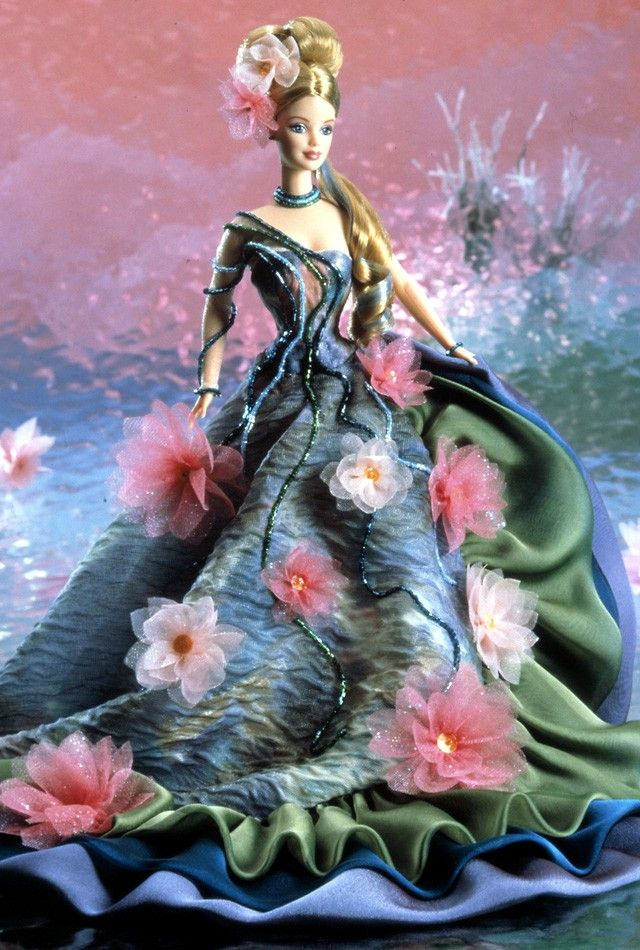 "I hate to say it, but this washed-out picture of Water Lily™ Barbie® really doesn't do her justice. Inspired by Monet's ""water lilies"" painting, if you couldn't tell. I'm not normally a big fan of extra-feminine things like pink and/or flowers, but it works so well with the aqua and green! She retailed for $79 back in 1997, as part of the Artist Series."