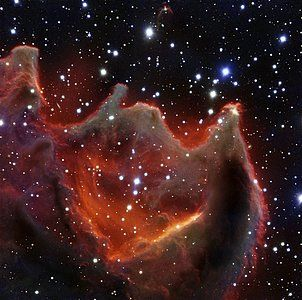 VLT image of the cometary globule CG4, glows menacingly in this image from ESO's Very Large Telescope. Although it looks huge and bright in this image it is actually a faint nebula and not easy to observe. The exact nature of CG4 remains a mystery. Constellation Puppis, 1300 ly distance