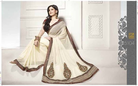 Net Saree in off white net,  The blouse is a shimmer fabric and there is a maroon shimmer border along the saree. The skirt of the saree have heavy zarodsi and stone work.   £149.99