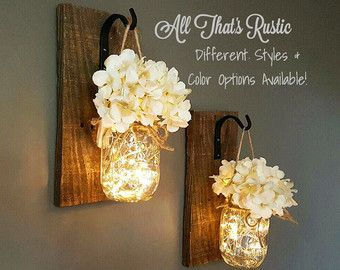 This listing is for a Set of 2 stunning Hanging Mason Jar Sconces. These sconces are hand crafted with the best quality. These make such wonderful rustic accents to any home decor! They are so versatile!! You will adore them for years to come :) These also make a unique and rustic gift for a housewarming or for any occasion! You can use them for several uses!!  **No flowers included in this listing!!** You have the option to purchase no lights or lights!  **If you want to purchase hydrangeas…