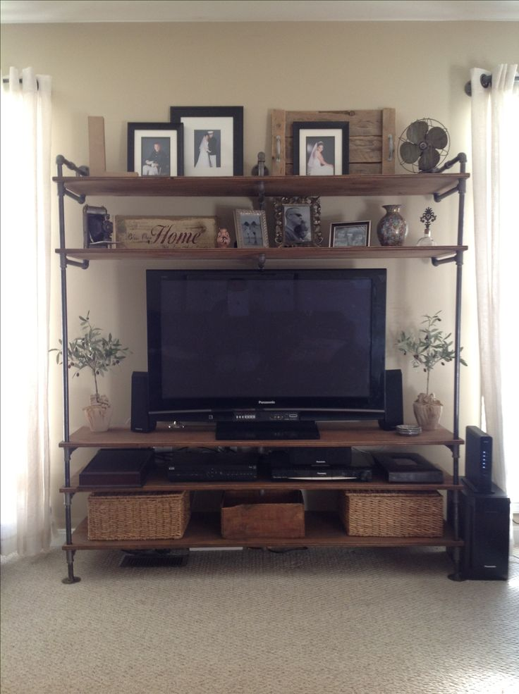Entertainment Center Made Out Of Cast Iron Pipes