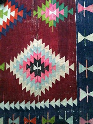 Aztec and tribal prints are going to be huge from runway to hallway! Add pattern to your living space