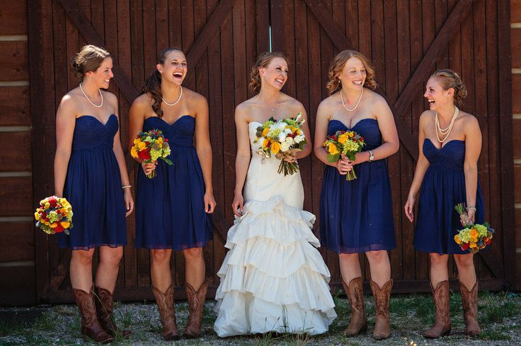 We love this bridal party pairing our Morgan dresses with cowboy boots!