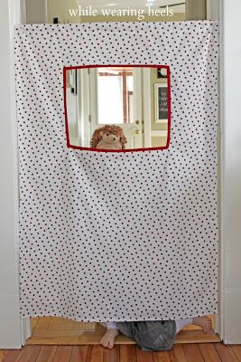 While Wearing Heels: Doorway Puppet Theater, perfect (inexpensive) gift for a child's birthday party.  Wonderful way to encourage imaginative play.