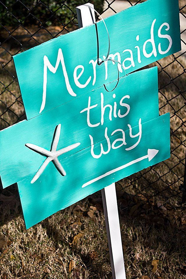 Mermaid sign, three boards, a little paint and a starfish....too easy.