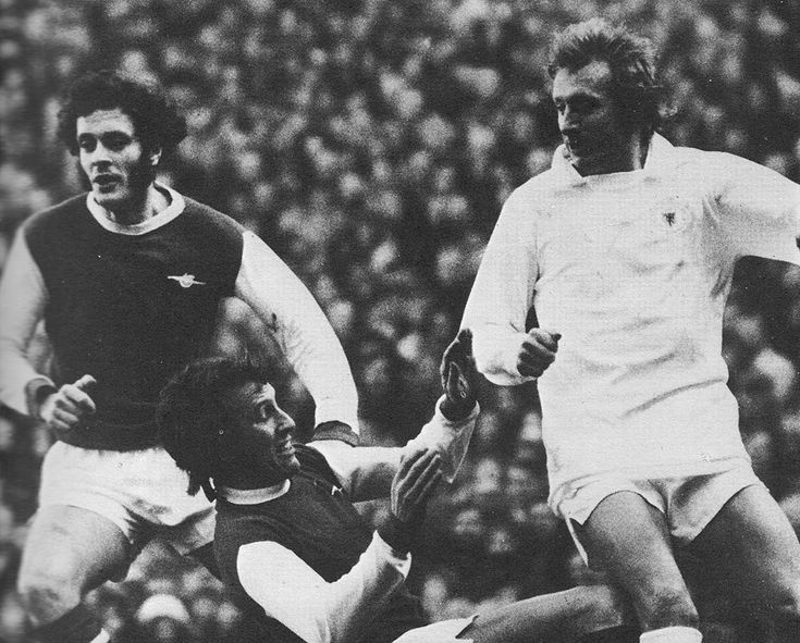 6th January 1973. Manchester United inside forward Denis Law avoiding Arsenal defensive duo Jeff Blockley and Bob McNab, at Highbury.