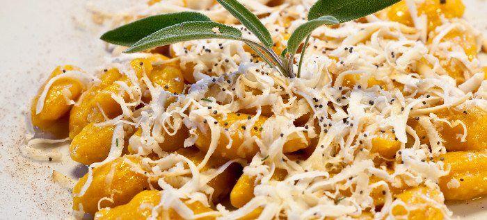 Pumpkin gnocchi with smoked ricotta cheese (typical food of Friuli region) - Gnocchi alla zucca con burro fuso e ricotta affumicata