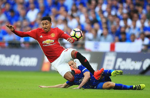 Jesse Lingard of Manchester United is fouled by Andy King of Leicester City during The FA Community Shield match between Leicester City and...
