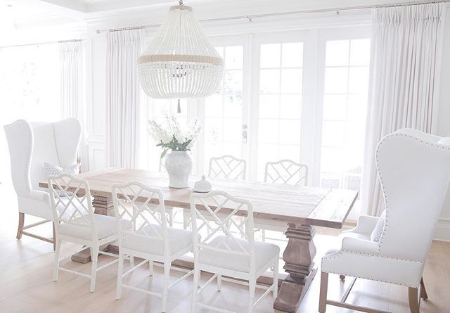 Dining room Restoration hardware Ballard designs dayna chairs Ro sham beaux chandelier Benjamin Moore simply white Coastal dining room Wing back chair Beaded chandelier