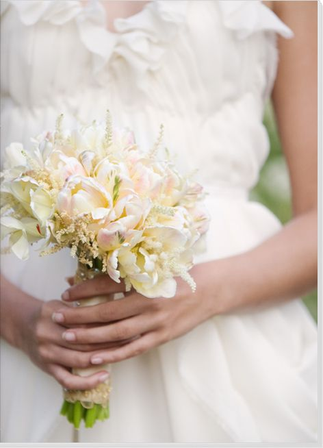 White parrot tulips with a slight pink hint are the main attraction to this beautiful bouquet featured in Utterly Engaged.